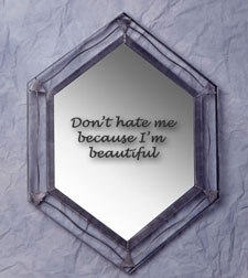 Mirror with 'Don't hate me because I'm beautiful' written on it