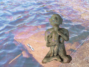 Archeological dig underwater with ancient mother figure
