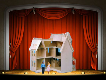 Dollhouse on stage with tiny couple
