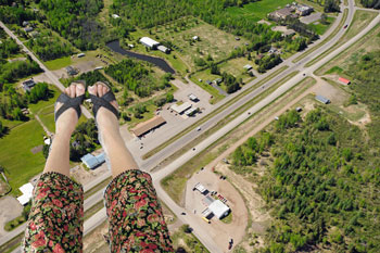 A woman's feet above an aerial landscape