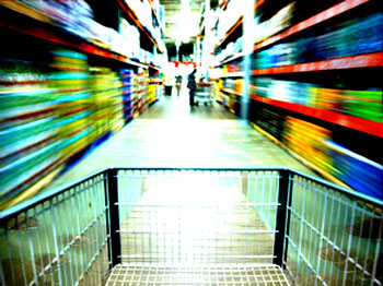 Shopping cart flying down a brightly lit blurry aisle
