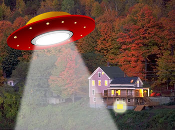 House at night with UFO