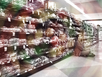 Man in bread aisle with swirling lights