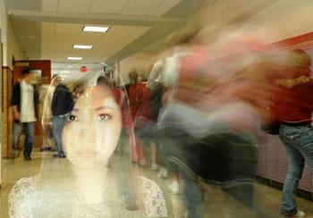 Ghostly girl in a high school hallway