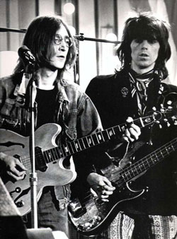 John Lennon performing with Keith Richards