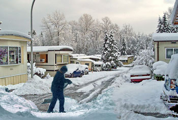 Man shoveling in trailer park