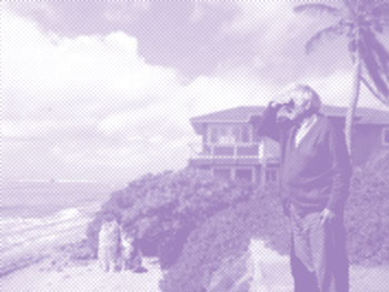 Old man looking at horizon in front of beach house