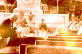 Couple talking at outdoor cafe, pixelated with color distortion