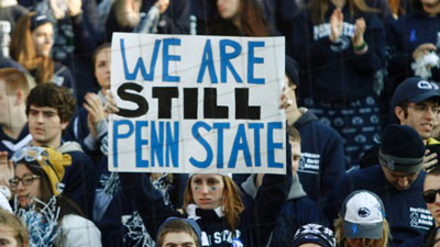 Student holding sign reading 'We are still Penn State'