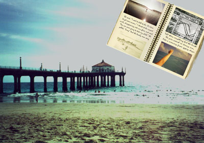 Beach with pier and sketchbook