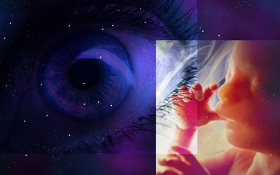 Starry background with superimposed eye and fetus