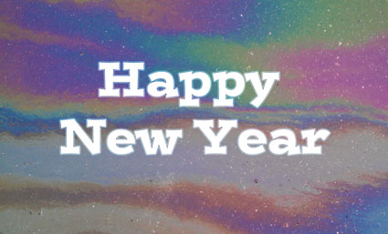 Happy New Year on rainbow oil background