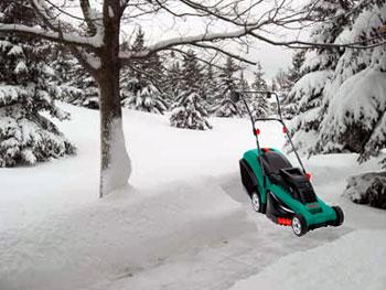 Snowy yard with lawn mower