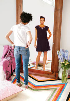 Woman seeing different version of self in mirror
