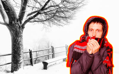 Wintry background with bundled up man with red