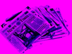 Purple stack of newspapers on a bright pink background
