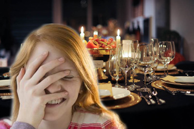 Young woman covering face with hand in front of fancy table spread