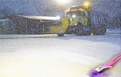 Snow plow with doll in foreground