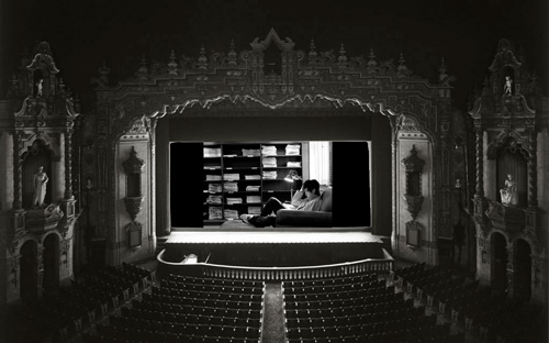 Movie theater with black and white film of guy reading