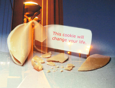 "Fortune cookie that reads ""This cookie will change your life"" superimposed over the Golden Gate Bridge."