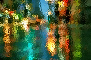 Blurry lights through streaks of rain