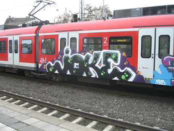 """Subway car with """"joke"""" painted on the side"""