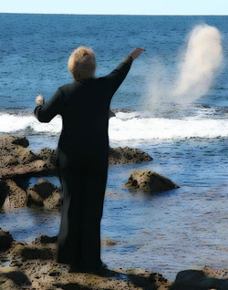 Woman scattering ashes on ocean