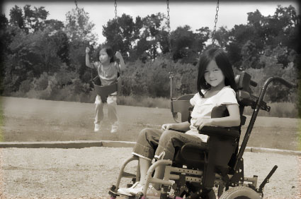 Girl on wheelchair on playground