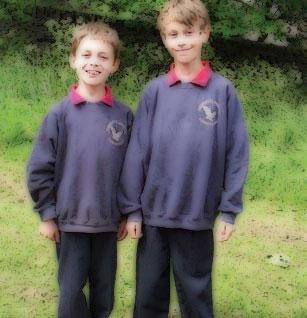 Boys in school uniform smiling