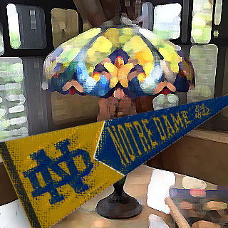 Tiffany reproduction lamp with Notre Dame pennant