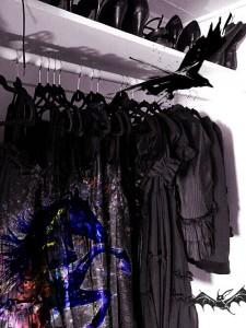 Closet of black clothes with crow, bat, horse