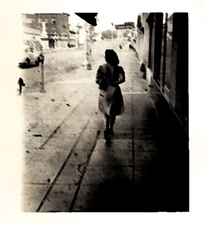 1940s woman walking down street