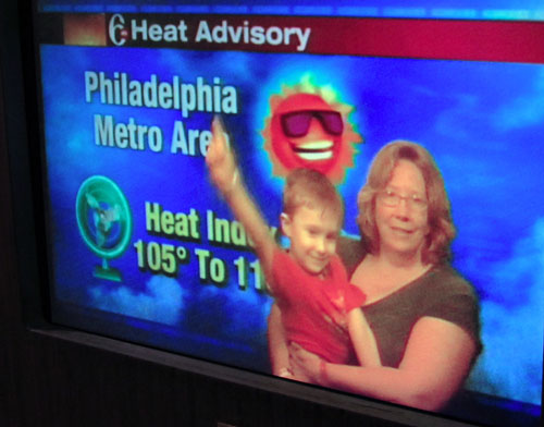 Alyce Wilson and son on blue screen, doing weather