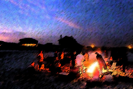 In the foreground is a beach bonfire with indistinct people around it, in front of a sky with fading sunlight and silhouettes of buildings.